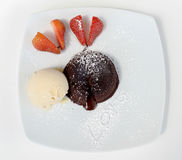 Chocolate lava with vanilla ice cream and strawberry to write lo Stock Photography