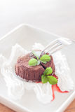 Chocolate lava with whipped cream and strawberry sauce Stock Photo