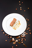 Chocolate Layer Cake with caramel, nuts and chocolate on white p Royalty Free Stock Photography