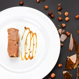 Chocolate Layer Cake with caramel, nuts and chocolate on white p Royalty Free Stock Photos