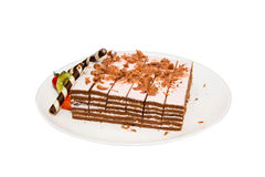 Chocolate layer cake decorated with fruit. Royalty Free Stock Image