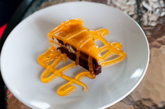 Chocolate layer cake with orange jam Stock Photos