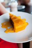 Chocolate layer cake with orange jam Stock Images