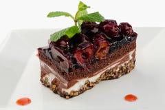 Chocolate layered cake with dark cherries Royalty Free Stock Photos
