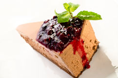 Chocolate layered mousse cake with dark cherries Stock Photos