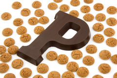 Chocolate letter P and ginger nuts for Sinterklaas Stock Photos