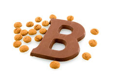 A chocolate letter with Sinterklaas candy. Isolated on white background stock photo