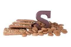 Chocolate letter, speculaas and ginger nuts, Dutch sweets at 5 december Royalty Free Stock Photography
