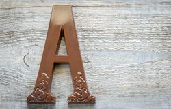 Chocolate letter on the wooden background Stock Photos