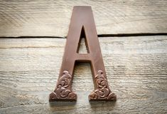 Chocolate letter on the wooden background Royalty Free Stock Photography