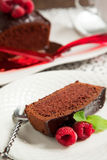 Chocolate loaf cake with chocolate frosting and raspberry Royalty Free Stock Images