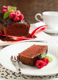 Chocolate loaf cake with chocolate frosting and raspberry Royalty Free Stock Photo