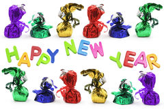 Chocolate Lollies with New Year Greetings Royalty Free Stock Images