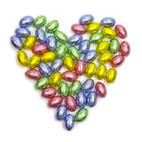 Chocolate love. Easter chocolate eggs in a heart shape Stock Images