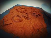 Chocolate love sweet symbol heart. Powder chocolate sweettime plate Stock Image