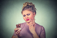 Chocolate lover woman with toothache sensitive teeth Stock Photo