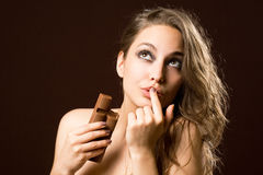 Chocolate loving brunette beauty Stock Photo