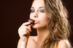 Chocolate loving brunette beauty Royalty Free Stock Photo