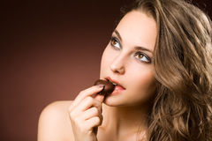 Chocolate loving brunette beauty Stock Photography