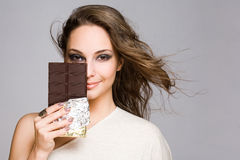 Chocolate loving brunette cutie. Stock Photos