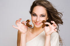 Chocolate loving brunette cutie. Stock Photography