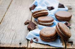 Chocolate macaron with cream cheese Stock Images