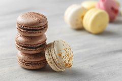 Chocolate Macarons Closeup, French Pastry Cookies royalty free stock images