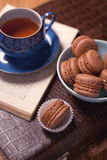 Chocolate Macarons and a Cup of Tea Stock Photo