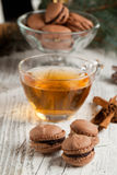 Chocolate macaroons and cup of tea Stock Image