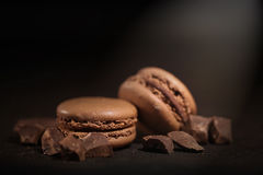 Chocolate macaroons. Pistachio macaroons macro black background royalty free stock images