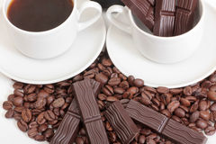 Chocolate and mag. Coffee cup and chocolate on a white background Stock Photo