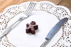 Chocolate man with fork and knife Stock Photo