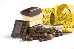 Chocolate and measure. Background; bar; bitter; black; block; broken; brown; cacao; candy; carbohydrates; chocolate; clip-art; cocoa; confectionery; creamy; dark royalty free stock photos