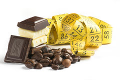 Chocolate and measure. Background, bar, bitter, black, block, broken, brown, cacao, candy, carbohydrates,  chocolate, clip-art, cocoa, confectionery, creamy Stock Images