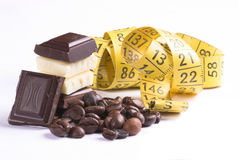 Chocolate and measure. Background, bar, bitter, black, block, broken, brown, cacao, candy, carbohydrates, chocolate, clip-art, cocoa, confectionery, creamy, dark royalty free stock images