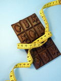 Chocolate and measuring tape Royalty Free Stock Photography