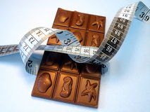 Chocolate and measuring tape Stock Photo