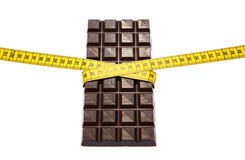 Chocolate with measuring tape Royalty Free Stock Images