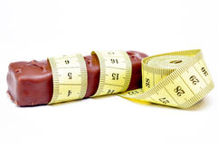Chocolate with a measuring tape Stock Image