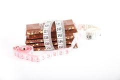 Chocolate and measuring type, isolated on white Stock Photos