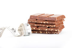 Chocolate and measuring type, isolated on white Stock Photography