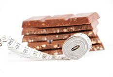 Chocolate and measuring type, isolated on white Stock Images