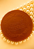 Chocolate medal on white pearl Royalty Free Stock Photo