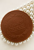 Chocolate medal on white pearl Royalty Free Stock Image