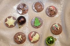Chocolate medals with Christmas decoration. Sweet present Royalty Free Stock Photos