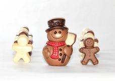 Chocolate men. Chocolate snowmen with a guard of chocolate gingerbread men Royalty Free Stock Photos