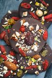 Chocolate Mendiant with Fruits and Nuts. Close up stock photos
