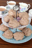 Chocolate meringues on cake stand Stock Photography