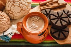 Chocolate mexicano and conchas, cup of mexican chocolate from oaxaca mexico. Chocolate mexicano, conchas mexican bread and a cup of mexican chocolate from oaxaca royalty free stock photo