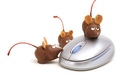 Chocolate mice on a mouse angle Royalty Free Stock Photo